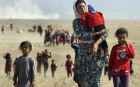 Yazidi people flee ISIS violence