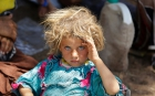 Yazidi girl rests after fleeing ISIS